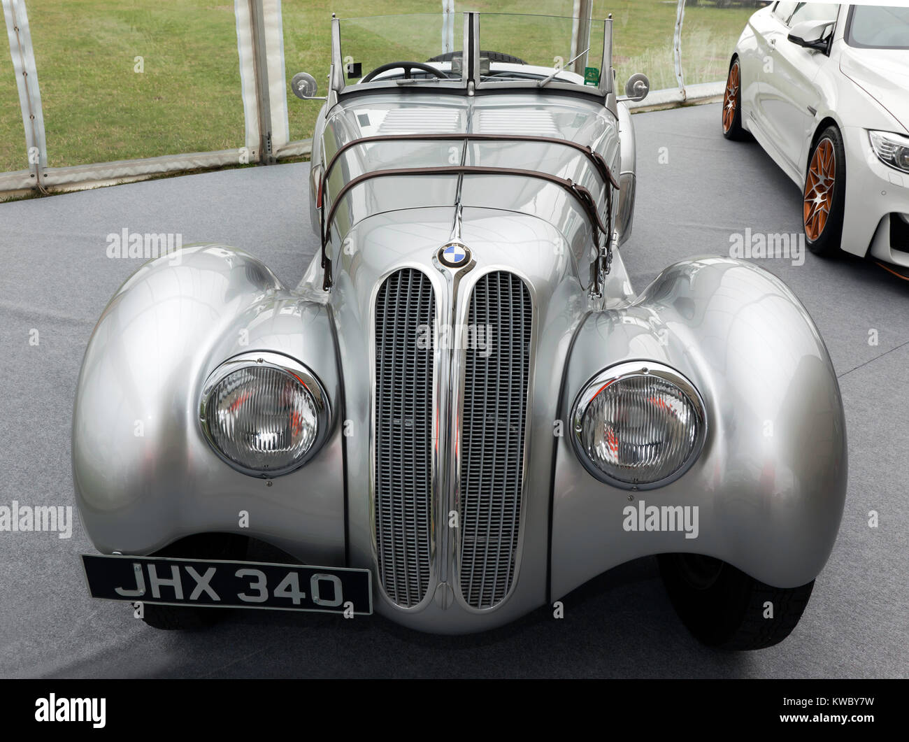 Front view of a 1933, Silver BMW 328  on static display in the BMW Car Club of great britian Ltd zone of the Silverstone - Stock Image