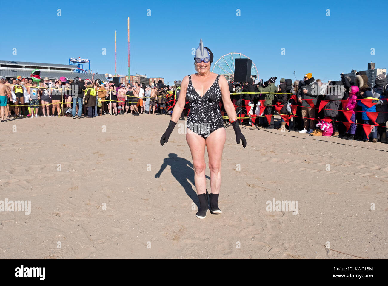 Posed portrait of a middle aged woman about to enter the water at the 114th Polar Bear Club New Year's Day swim. - Stock Image
