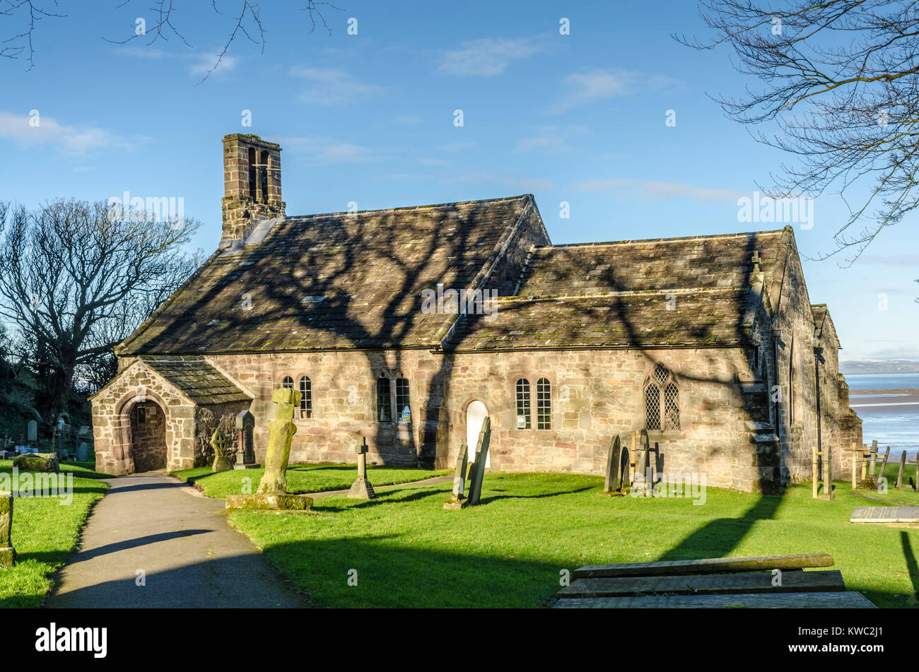 St Peter's Church in the village of Heysham, Lancashire, England. It is recorded in the National Heritage List - Stock Image