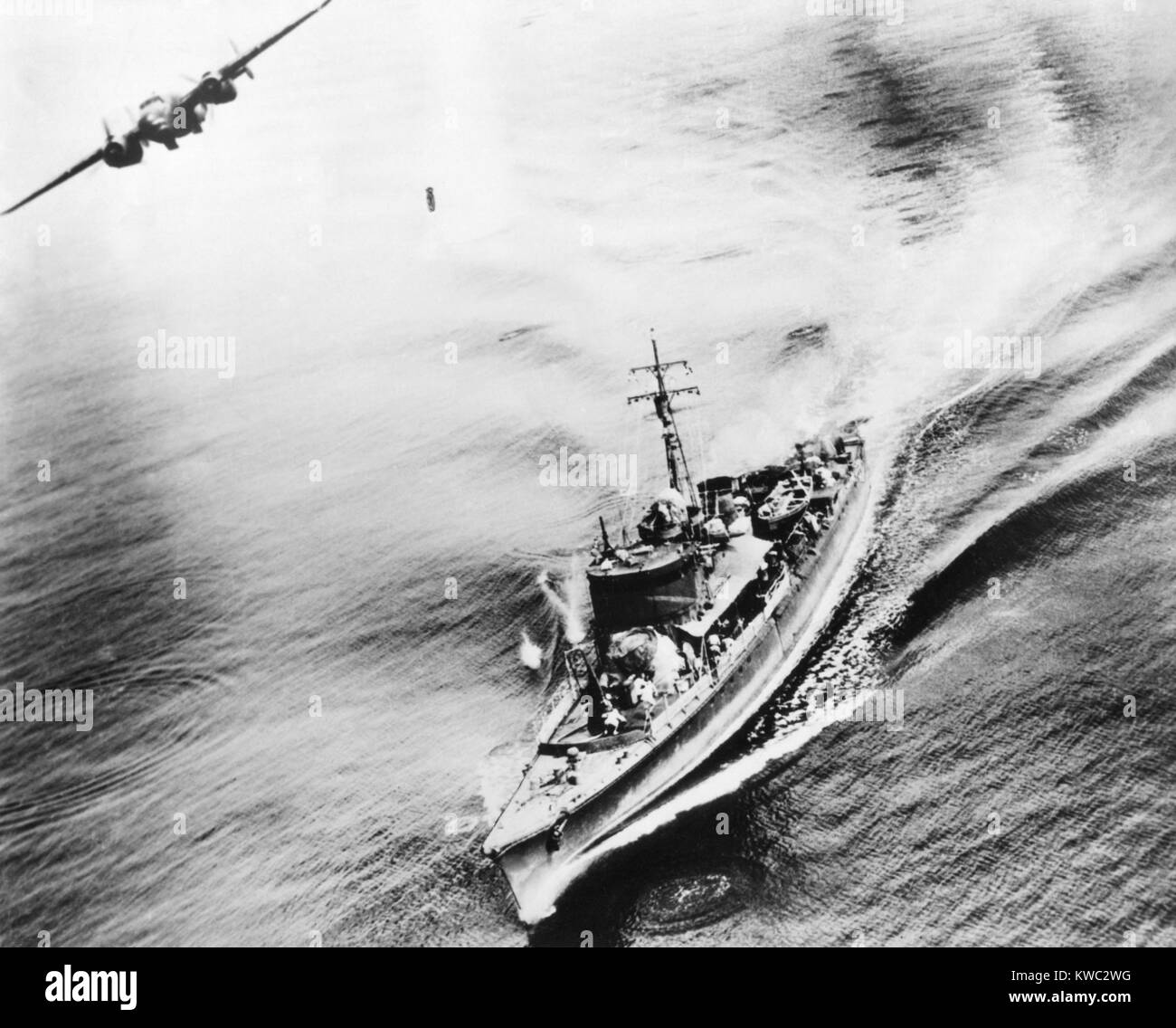Small Japanese war vessel bombed by U.S. B-25 bomber in the Bismarck Sea, March 21, 1944. The ships crew can be - Stock Image
