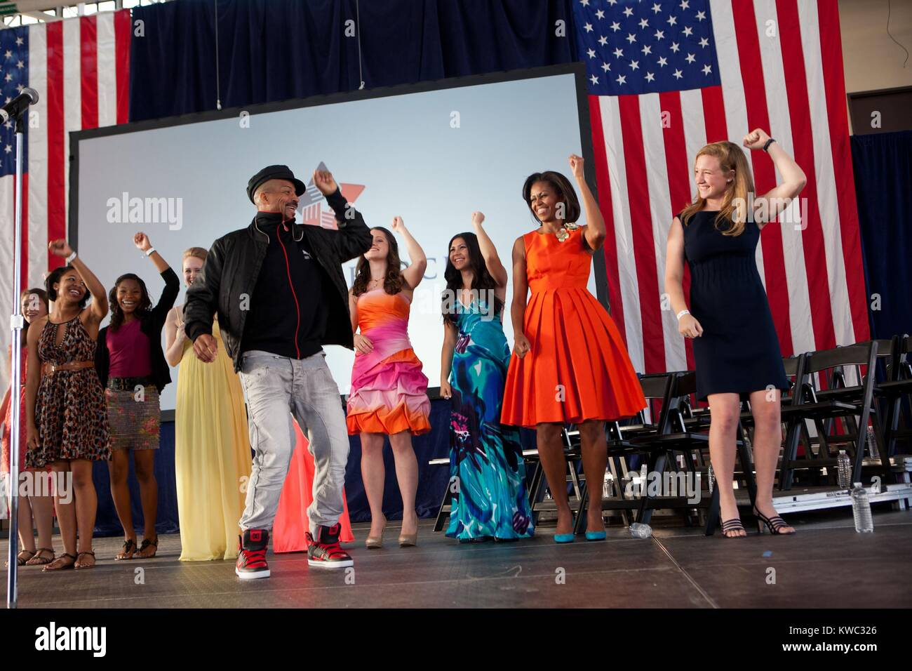 Choreographer Rosero McCoy leads a dance event at Jacksonville Naval Air Station. First Lady Michelle Obama and - Stock Image