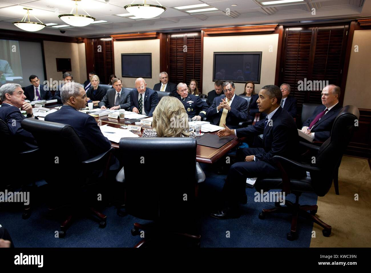 President Barack Obama meets with members of his National Security team in the Situation Room. White House, Oct. - Stock Image