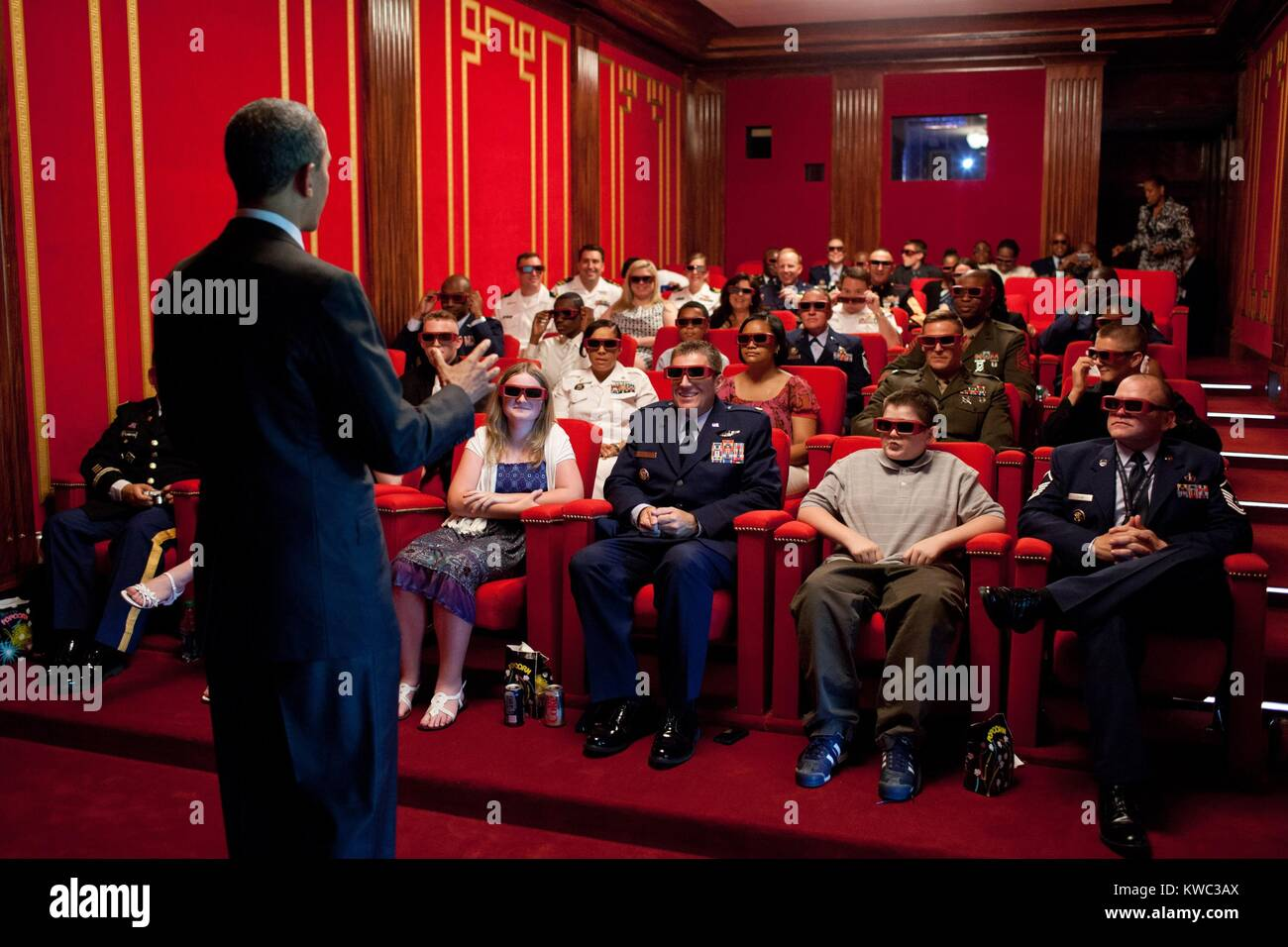 President Obama welcomes service members and their families to the White House Family Theater. They are prepared - Stock Image