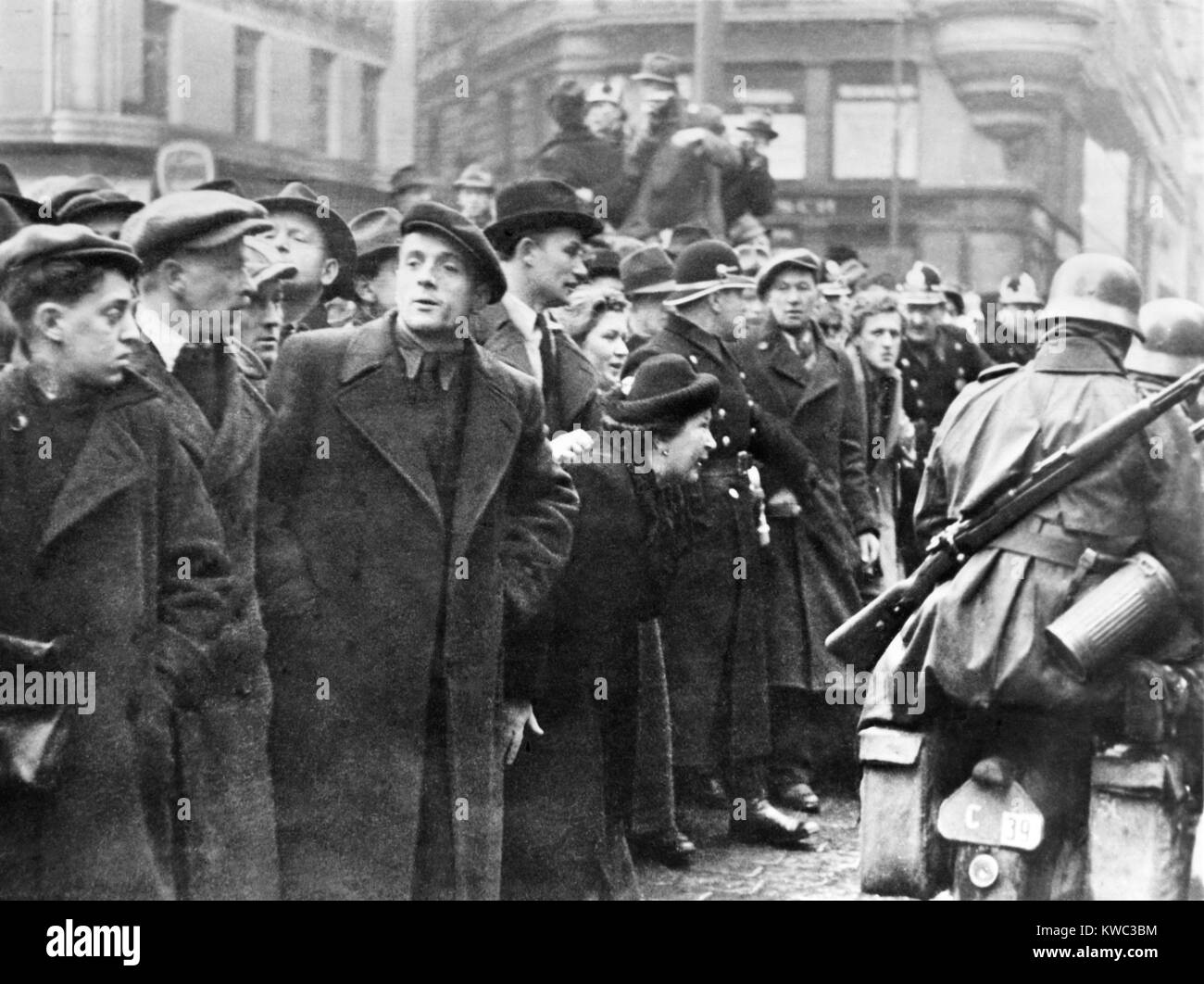 Residents of Prague, Czechoslovakia, watch invading German army, March 1939. (BSLOC_2015_13_32) - Stock Image