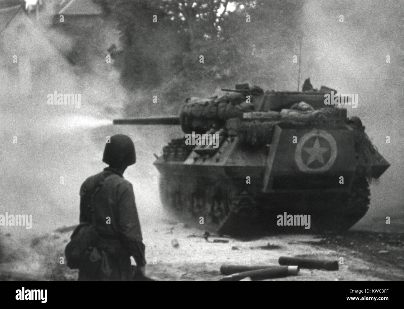 U.S. tank firing in Saint Lo, France, July 1944. The Norman town strategically located at the intersection of main - Stock Image