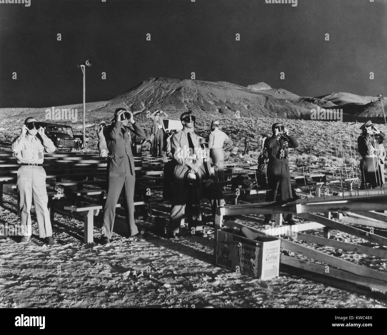 Canadian and British observers illumined by both the sun and an atomic blast of ABLE, a 1-kiloton atomic bomb. January - Stock Image