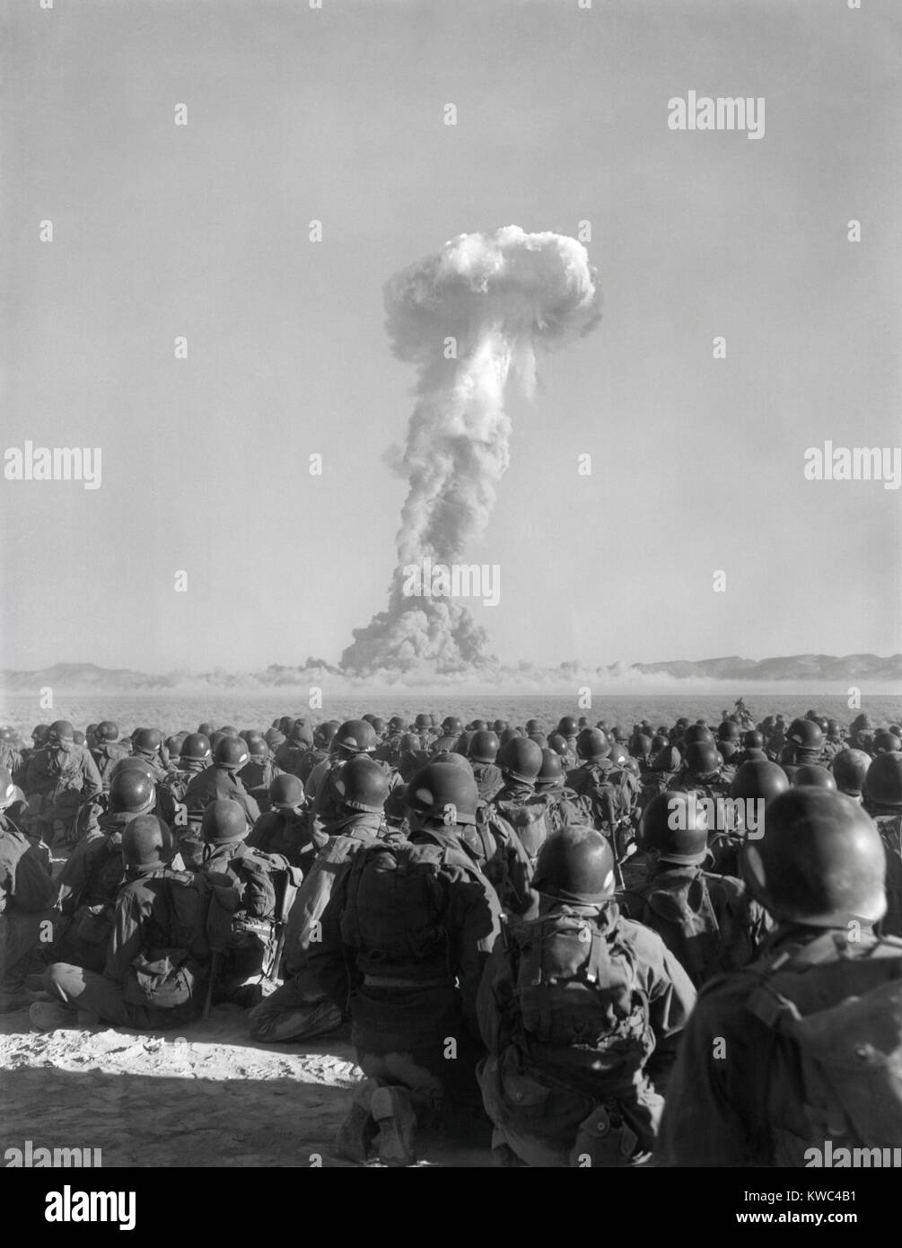 Exercise Desert Rock, Nov. 1, 1951. Men of the U.S. Army 11th Airborne Division, watch a plume of radio-active smoke - Stock Image