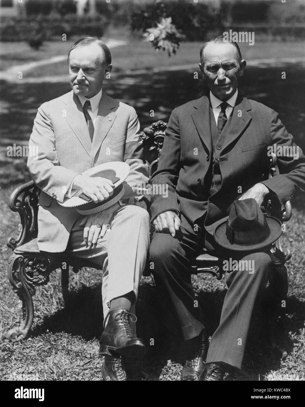 President Coolidge and his father, George Tryon Harding, Sr. seated on the White House lawn. July 1924, shortly - Stock Image