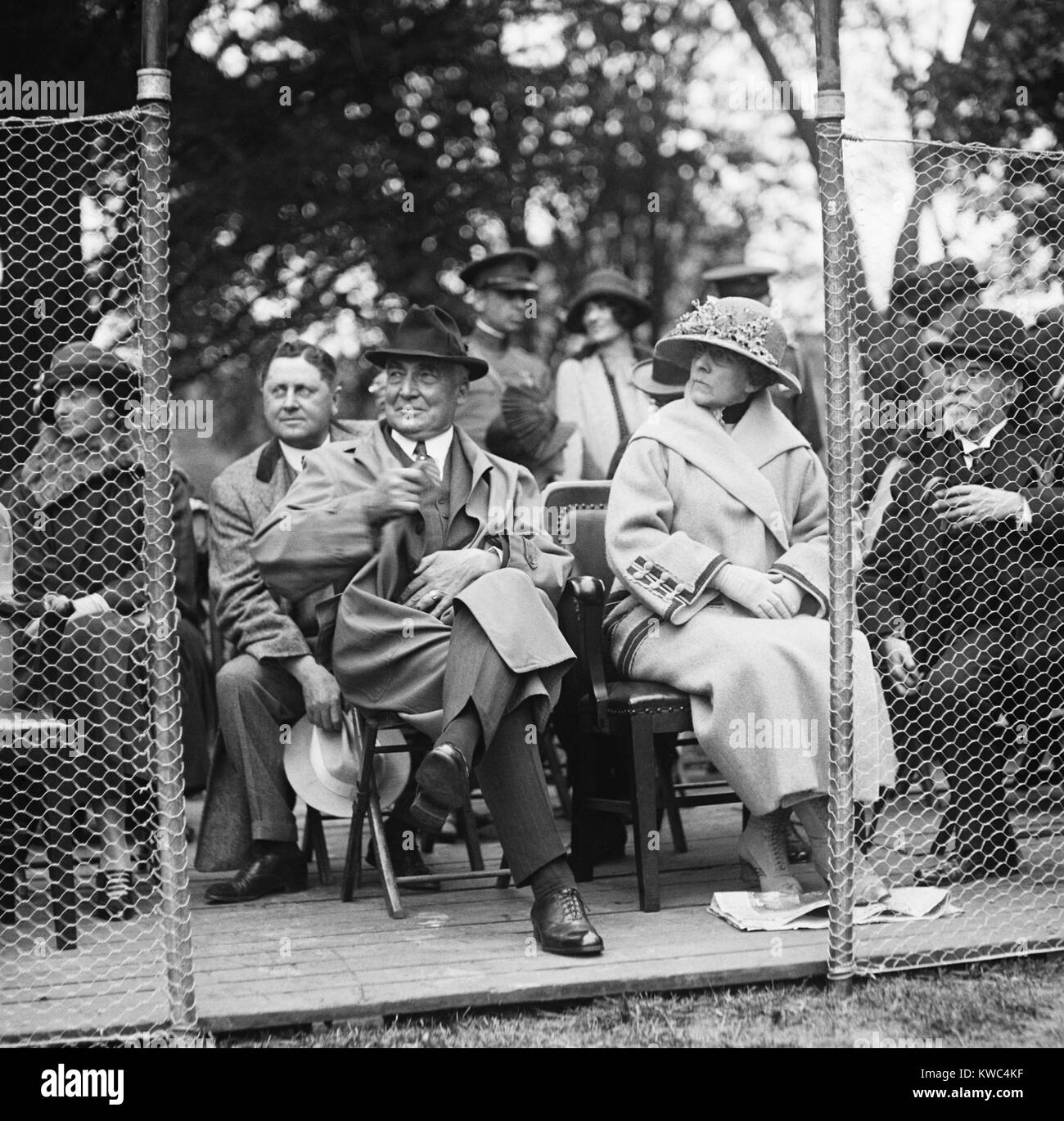 President Warren Harding and First Lady watching a tennis match on the White House courts. The match featured Manuel - Stock Image