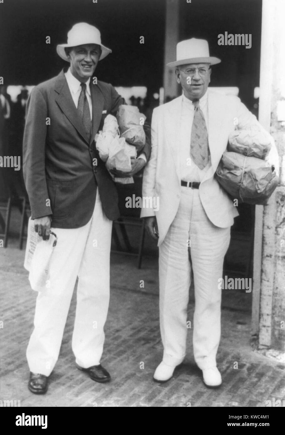 FDR's feuding but indispensable New Dealers, Harold L. Ickes and Harry Hopkins. Oct. 19, 1935 during a trip - Stock Image