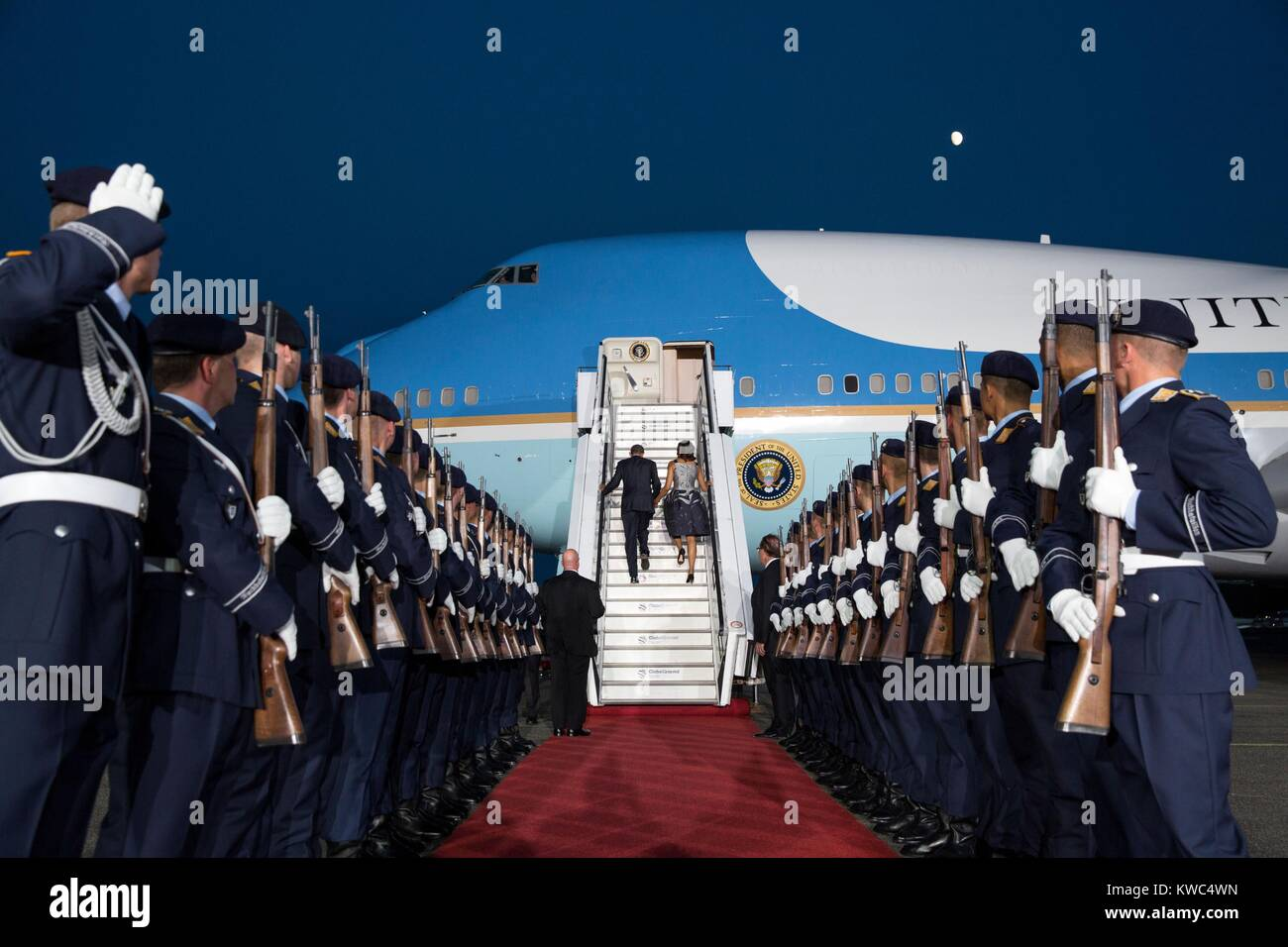 President Barack Obama and First Lady Michelle Obama departing Berlin, Germany. June 19, 2013. A 25 man honor guard lines their path at U.S. Air Force One at Tegel Airport (BSLOC_2015_13_135) Stock Photo