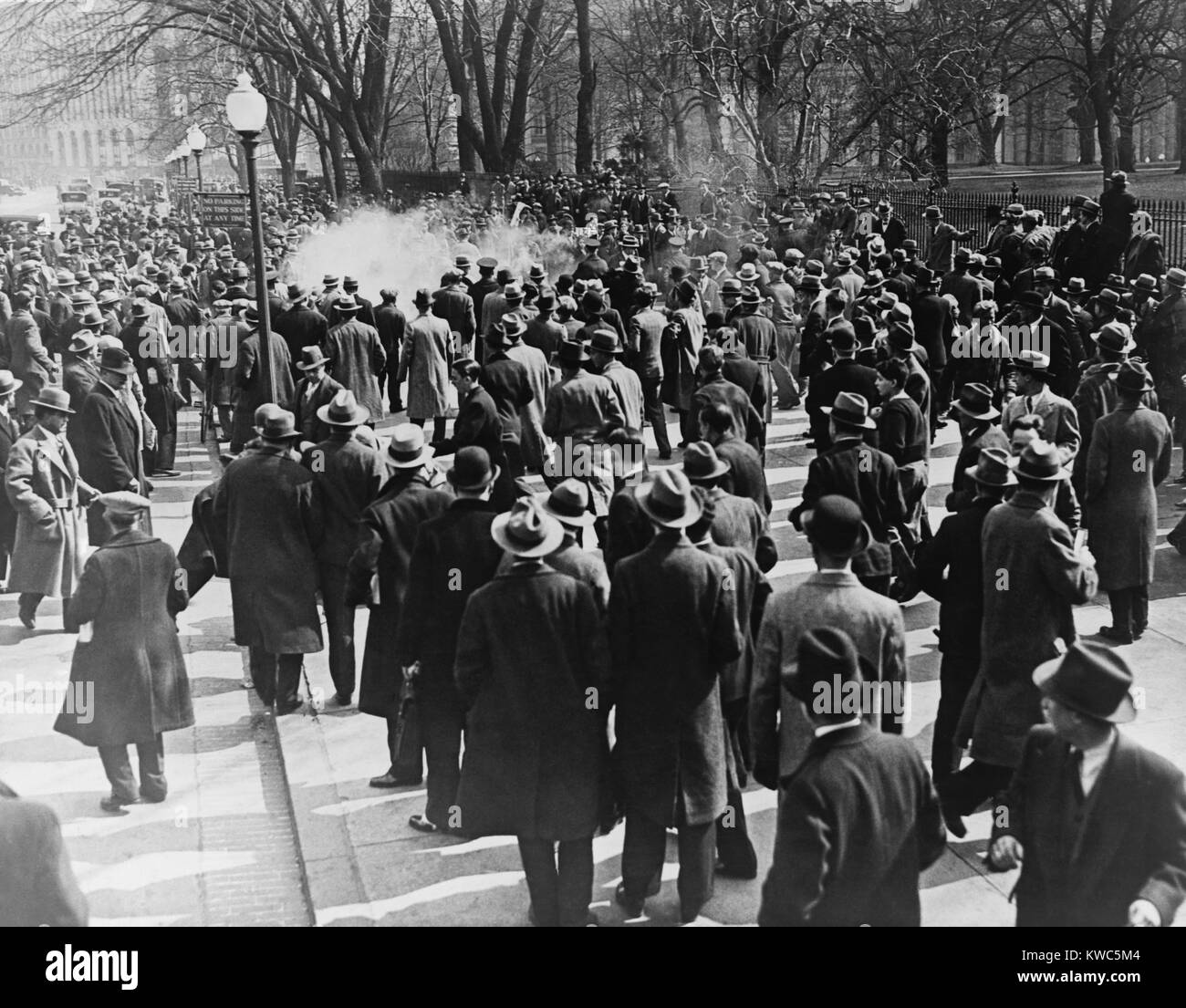 International Unemployment Day at the White House, Washington, D.C. Police used tear gas bombs, night sticks and - Stock Image