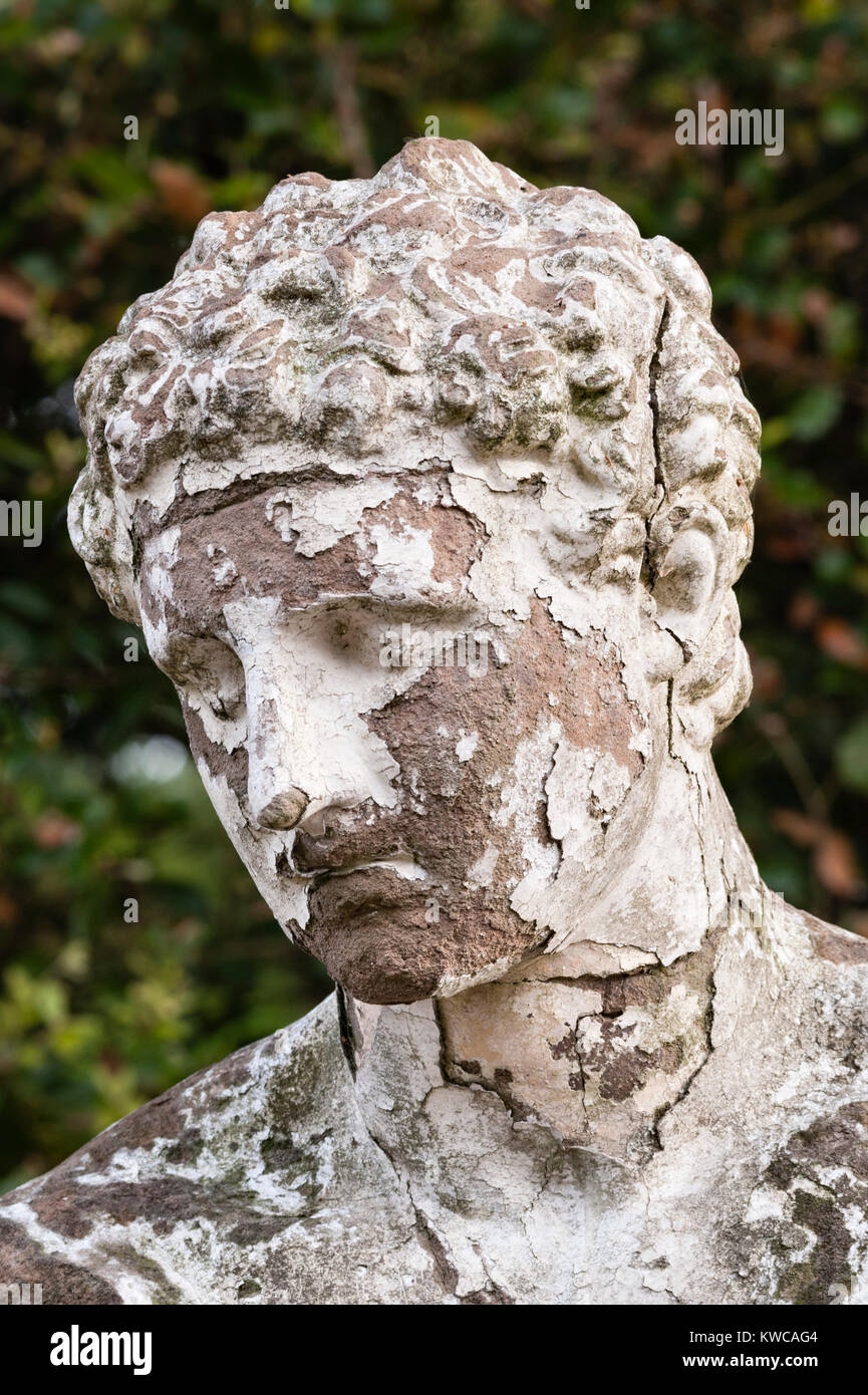 Mount Edgcumbe House, Plymouth, Cornwall, UK. Peeling paint on a sad and neglected terracotta statue in the formal - Stock Image