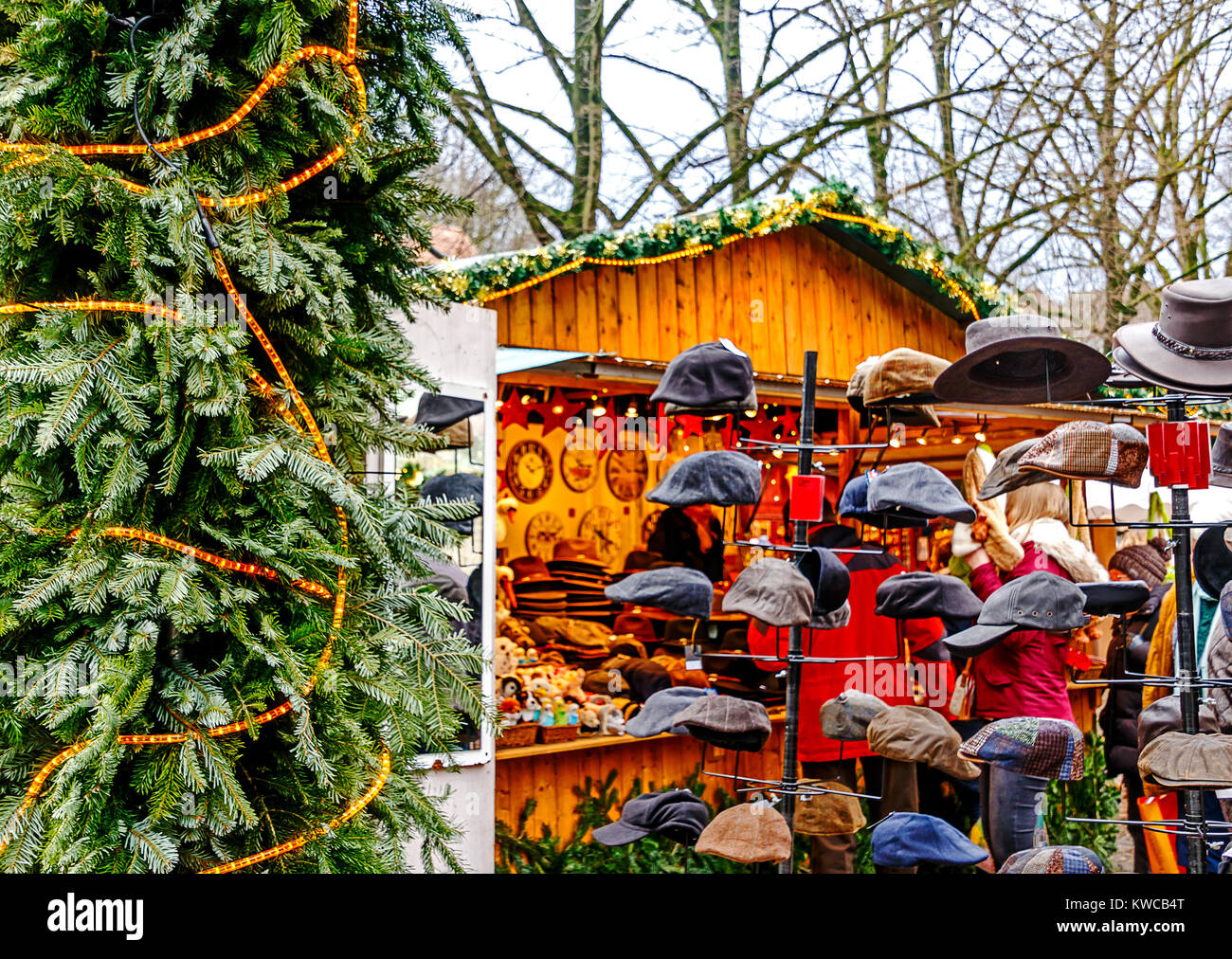 Shopping for Caps at a German Christmas Market - Stock Image