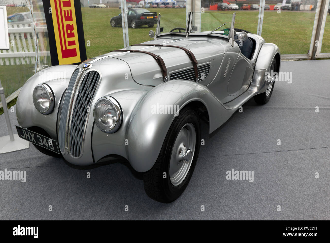 Three-quarter front view of a 1933, Silver BMW 328  on static display in the BMW Car Club of great britian Ltd zone - Stock Image