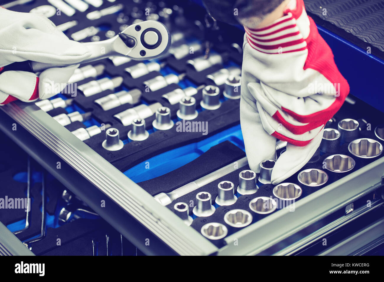 hand of auto mechanic picking spanner out of tools drawer - Stock Image