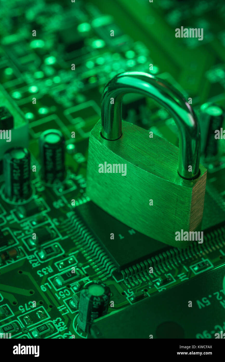 Padlock resting on a circuit-board - as visual metaphor for concept of secure data, email security, data protectio,secure - Stock Image