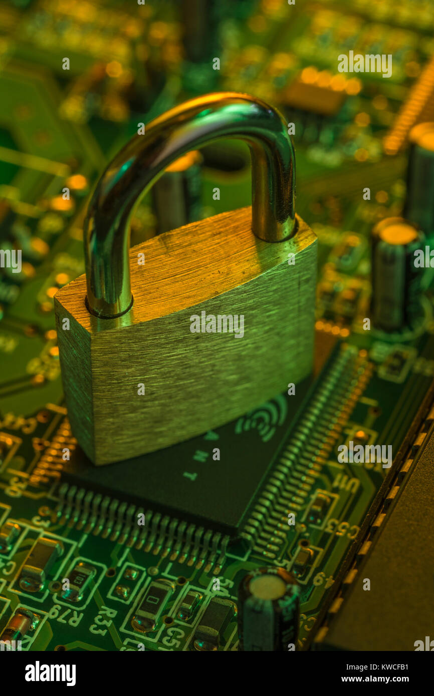 Padlock resting on a circuit-board - as visual metaphor for concept of secure data, email security, data protection,secure - Stock Image