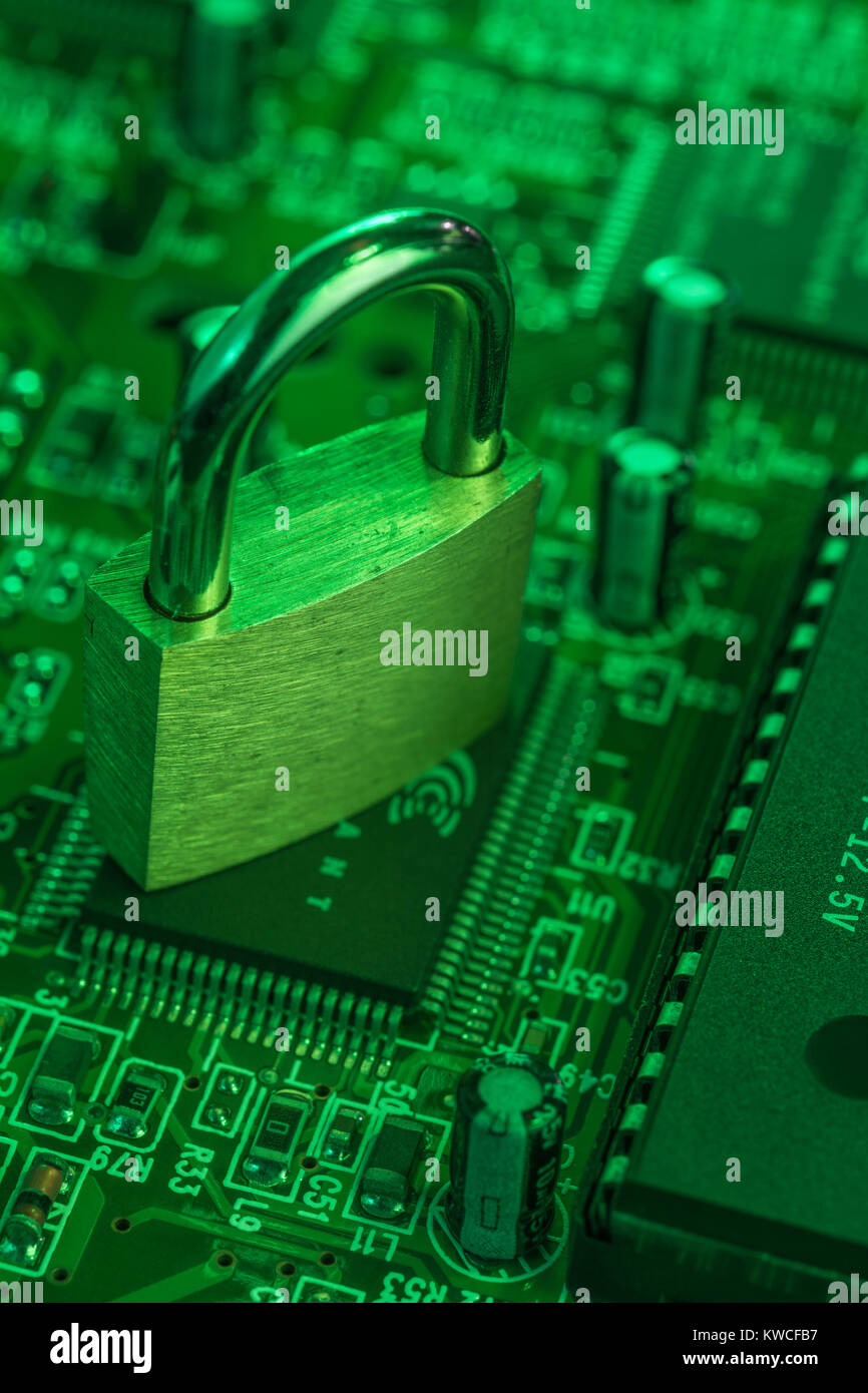 Padlock resting on a circuit-board - as visual metaphor for concept of secure data, email security, data protection, - Stock Image