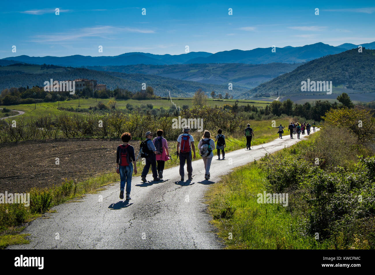 Volterra, Pisa, Italy - November 1, 2017: Hikers depart from Saline for the Volterra hills with panoramic views - Stock Image
