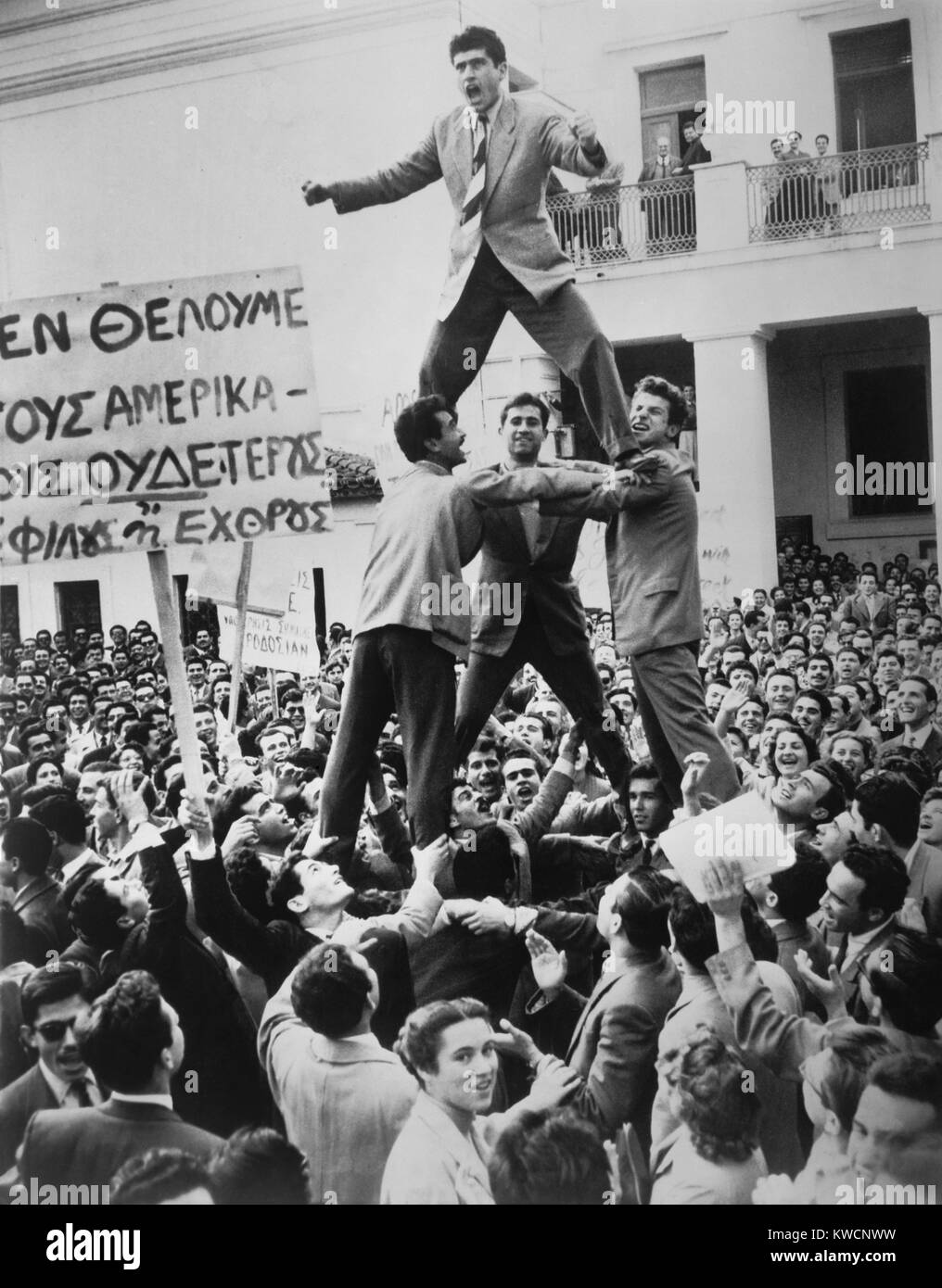 Greek students protest against British occupation of Cyprus. 4,000 students assembled in Athens watch young men - Stock Image