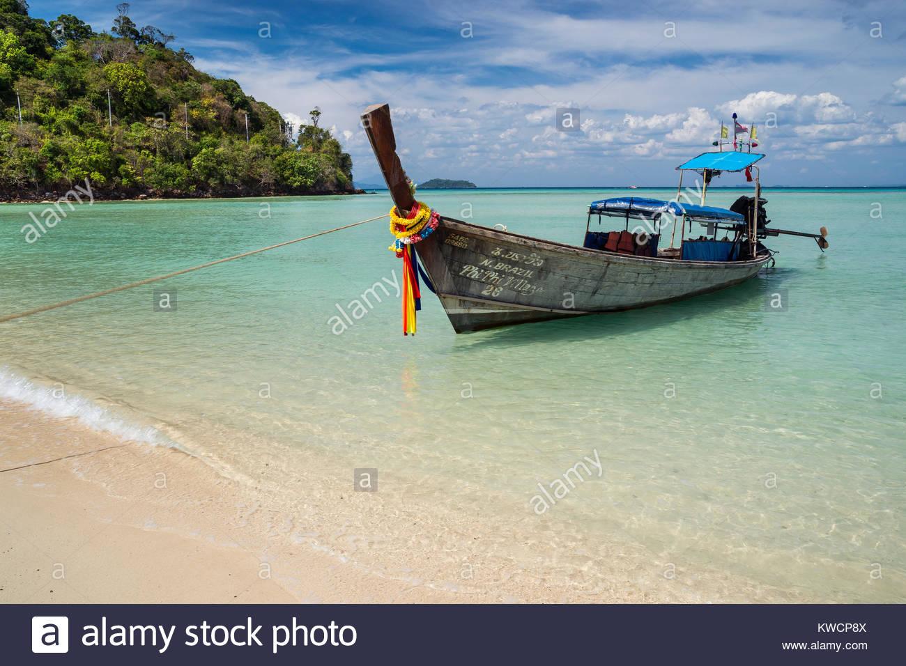 Long tail boat in Loh Bagao Bay - Koh Phi Phi Don - Thailand Stock Photo