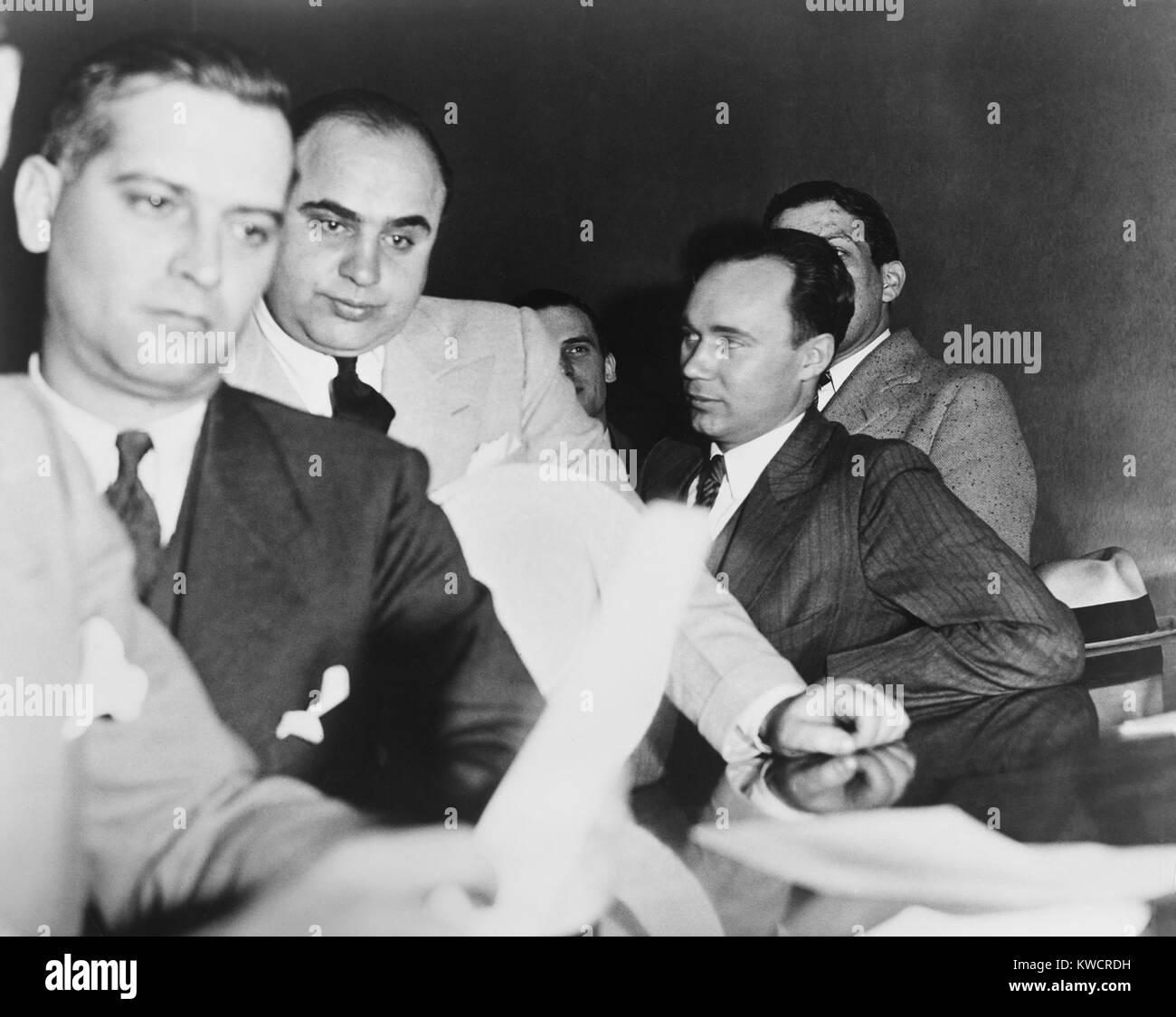 Al Capone, at the time of his indictment for tax evasion, June 5, 1931. At right is one of Capone's attorneys, Michael Stock Photo