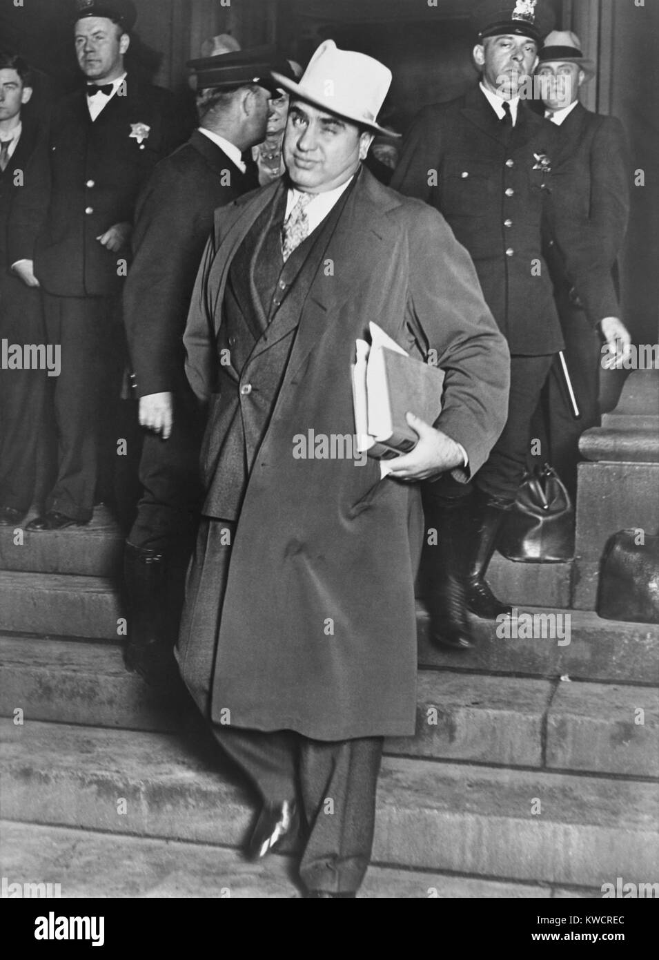 Al Capone, winks at photographers as he leaves Chicago's federal courthouse. October 14, 1931. The notorious Chicago Stock Photo