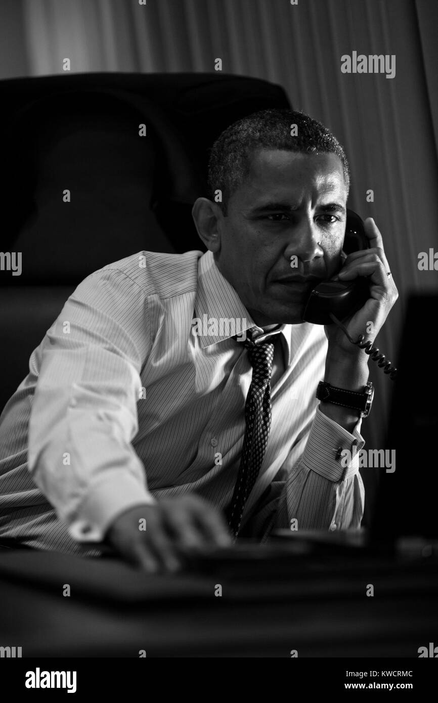 President Barack Obama talks on the phone from Air Force One. June 6, 2012. (BSLOC 2015 3 8) Stock Photo