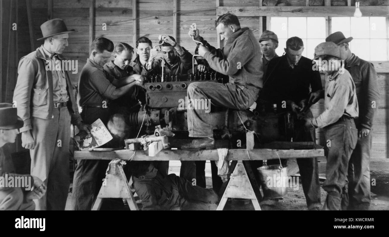 Civilian Conservation Corps (CCC) class learning about a gasoline motor. Arcadia, Louisiana, 1937-42. - (BSLOC_2015 - Stock Image