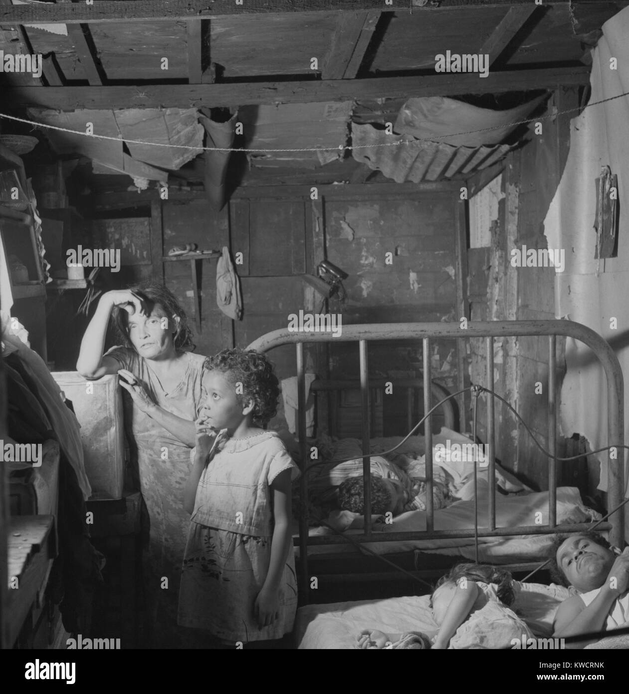 Five members of a family in a small bedroom of a worker's shack. San Juan, Puerto Rico. Jan. 1938. - (BSLOC - Stock Image