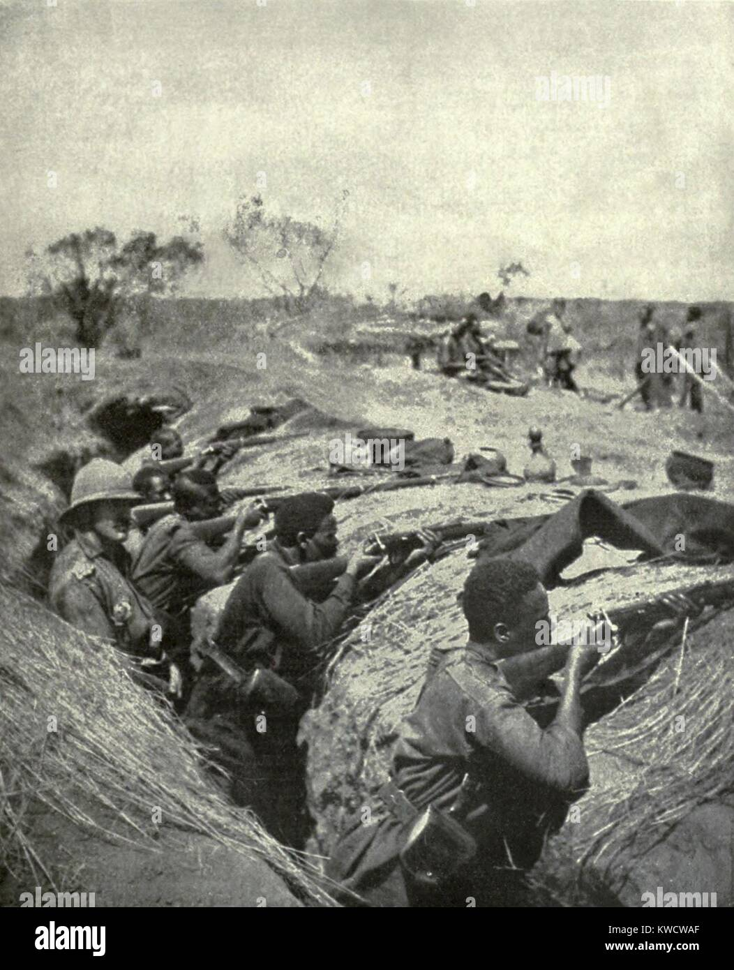 World War 1 in Africa. African troops in an entrenched camp at rifle practice. They are being trained to use modern - Stock Image