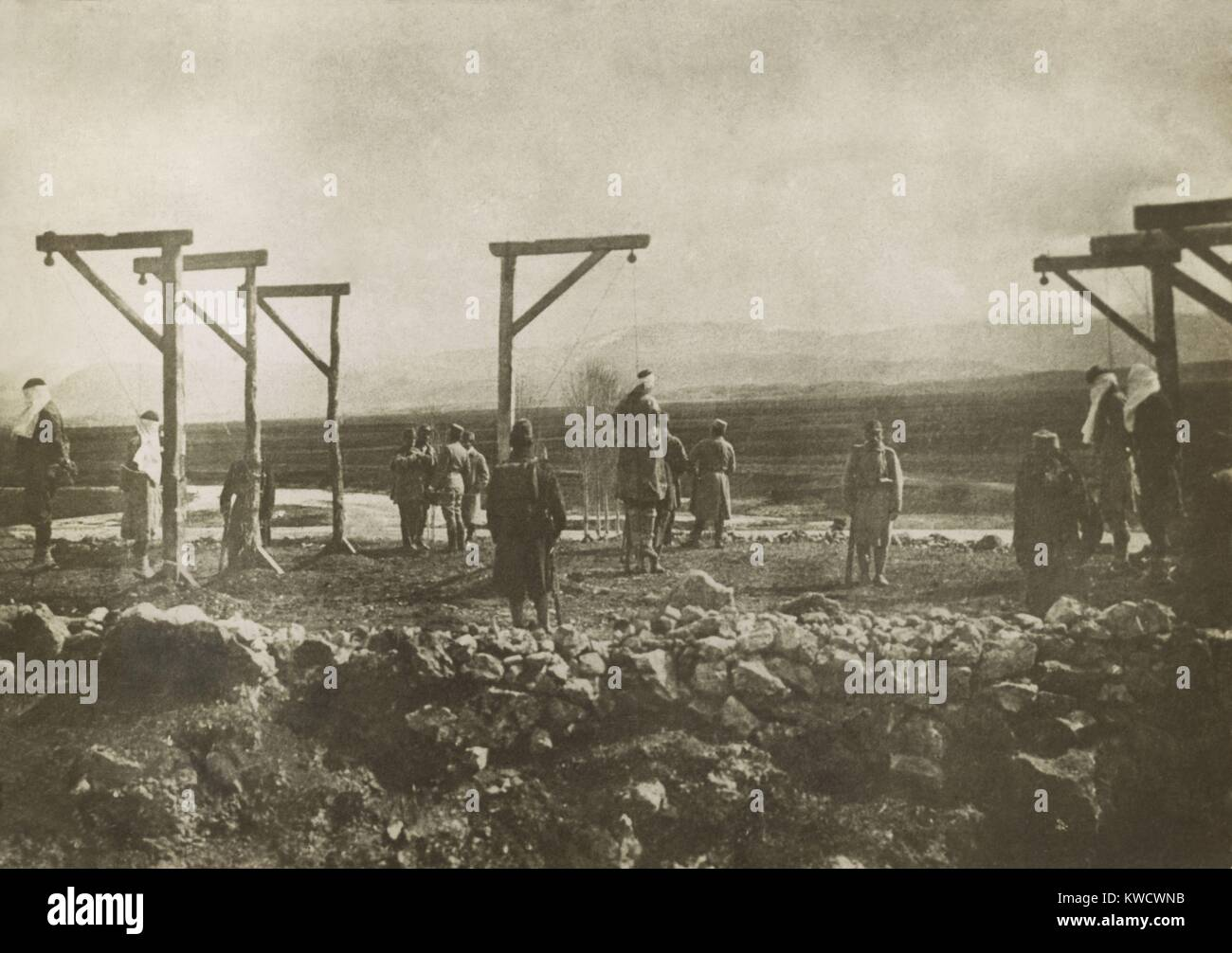 Austrian soldiers executing Serbian civilians by hanging during World War 1. Habsburg military courts issued death - Stock Image