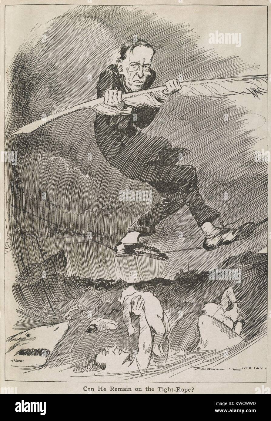 CAN HE REMAIN ON THE TIGHT-ROPE? President Woodrow Wilson balancing with a quill pen, on a tightrope over a shark - Stock Image