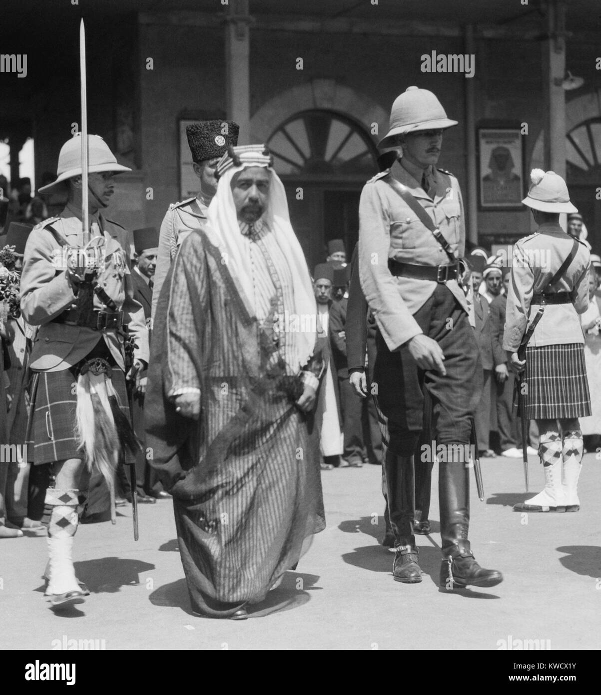 Abdullah I bin al-Hussein, Emir of Transjordan, walking between two British military personel. He was in Jerusalem - Stock Image