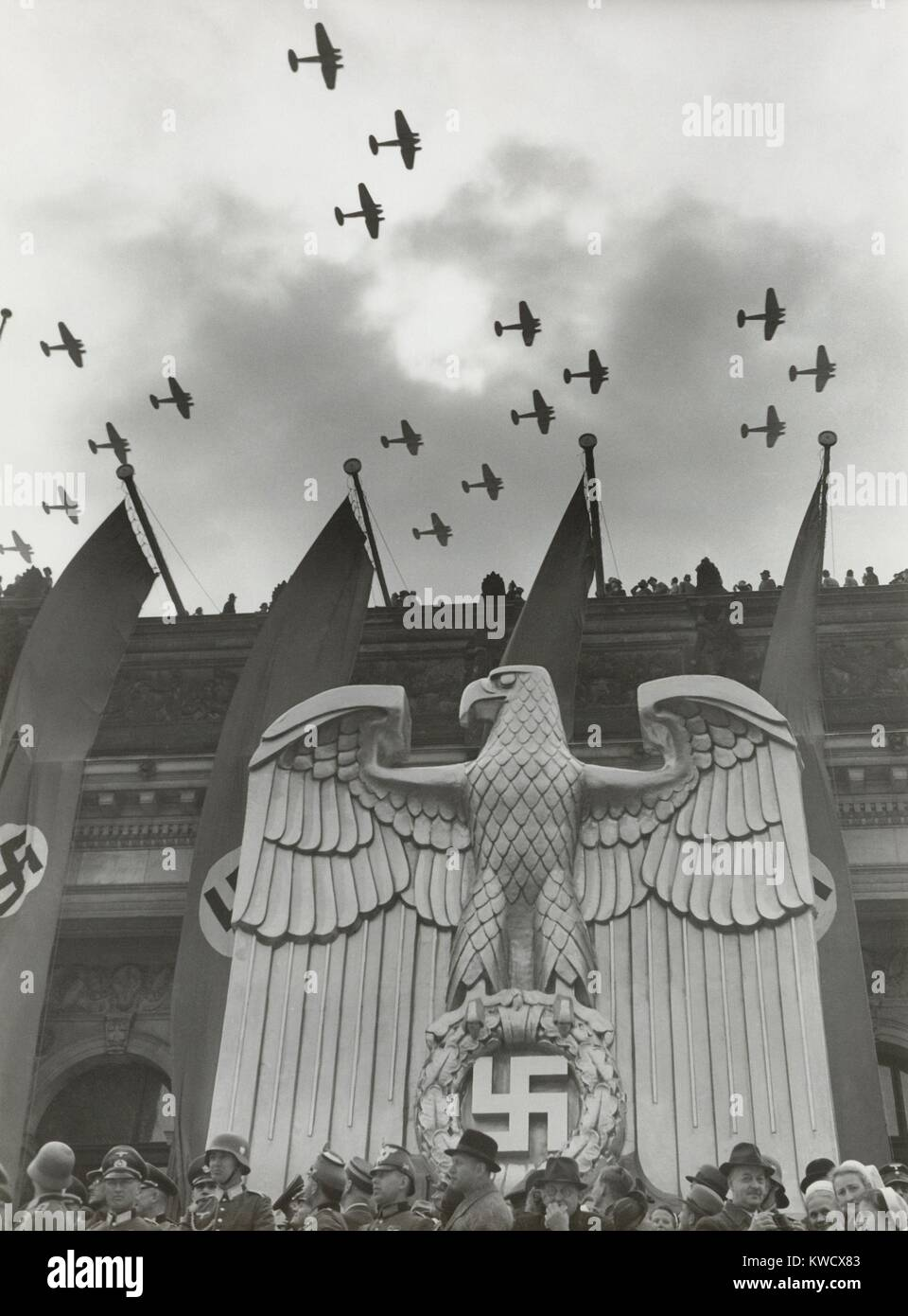 Luftwaffe Fly-By in honor of Hitlers birthday in Charlottenburg, Berlin, April 20, 1939. On the building is a sculpture Stock Photo