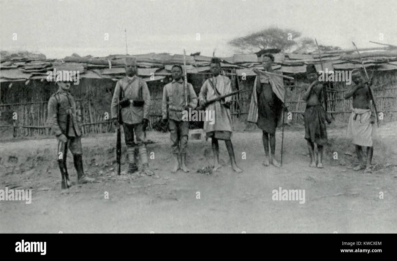 World War 1 in Africa. The transformation the German Askaris (native soldiers). At right are three natives with - Stock Image