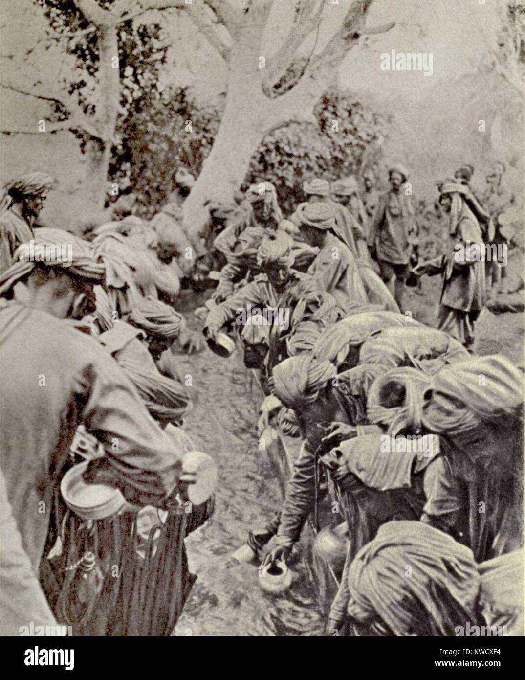 World War 1 in Africa. Indian Sepoys fought for the British in East Africa. Photo shows them crowding around a camp - Stock Image