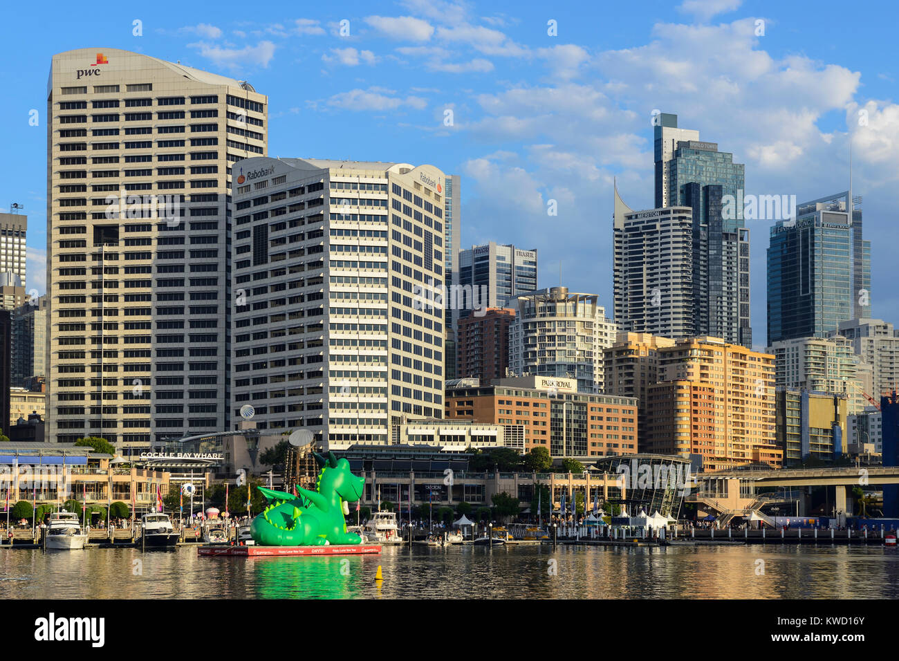 Cockle Bay Wharf in Darling Harbour with high-rise buildings in Sydney Central Business District in background  - Stock Image