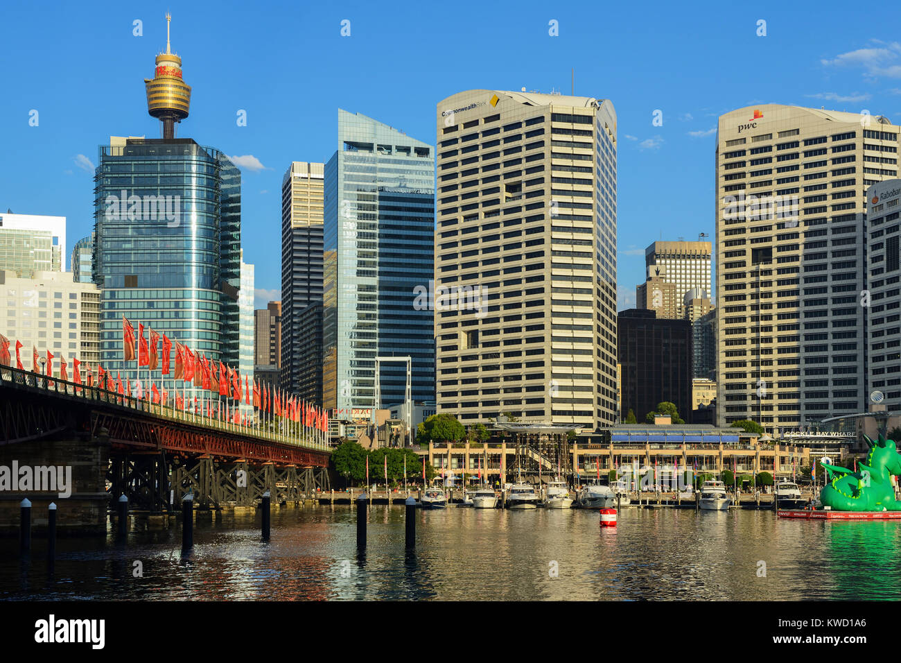 Pyrmont Bridge and Cockle Bay Wharf in Darling Harbour, with Sydney Central Business District in background - Sydney, - Stock Image