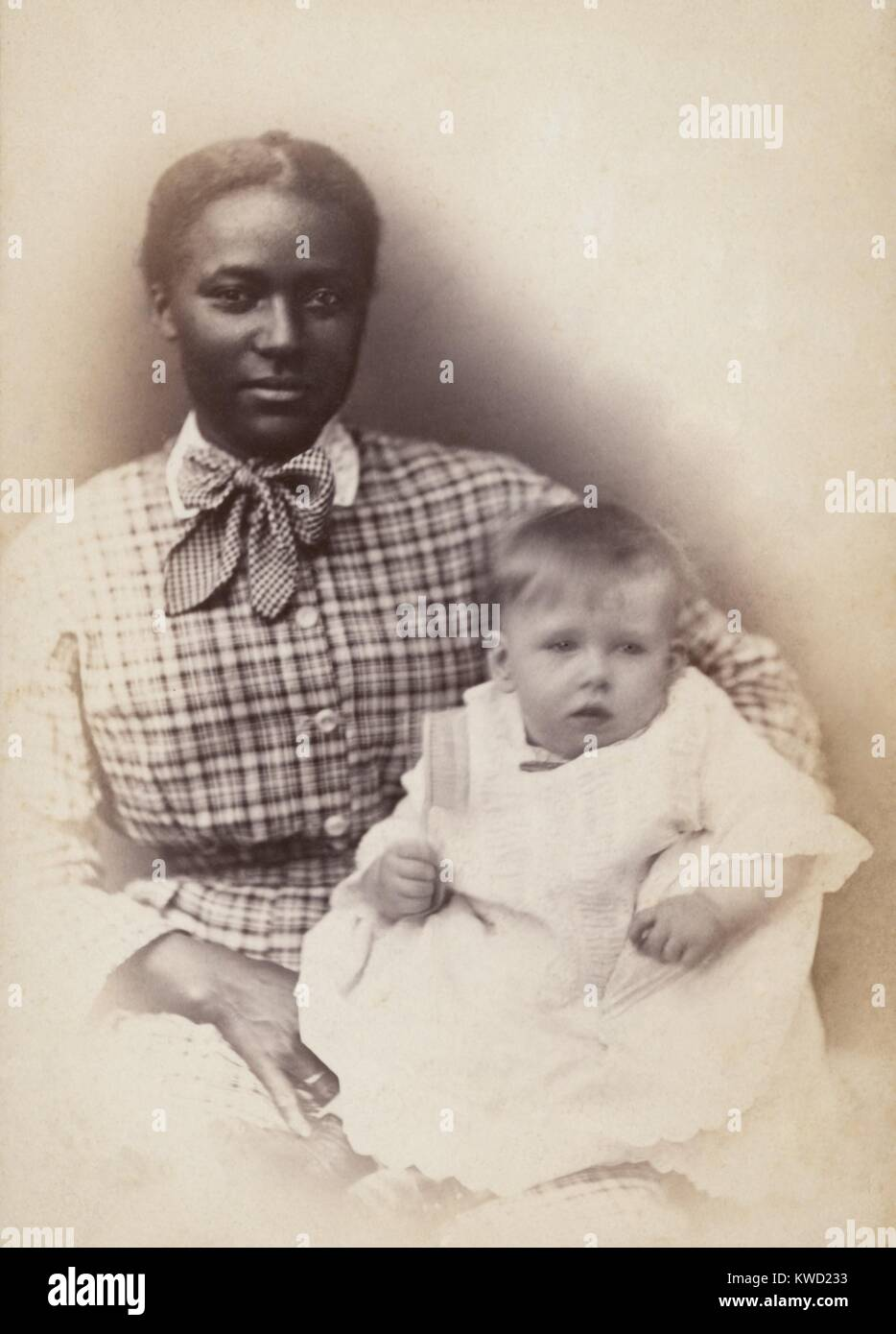 Young African American woman holds a white baby, c. 1870-1880. Photo by Solomon Nunes Carvalho  (BSLOC_2017_20_110) - Stock Image