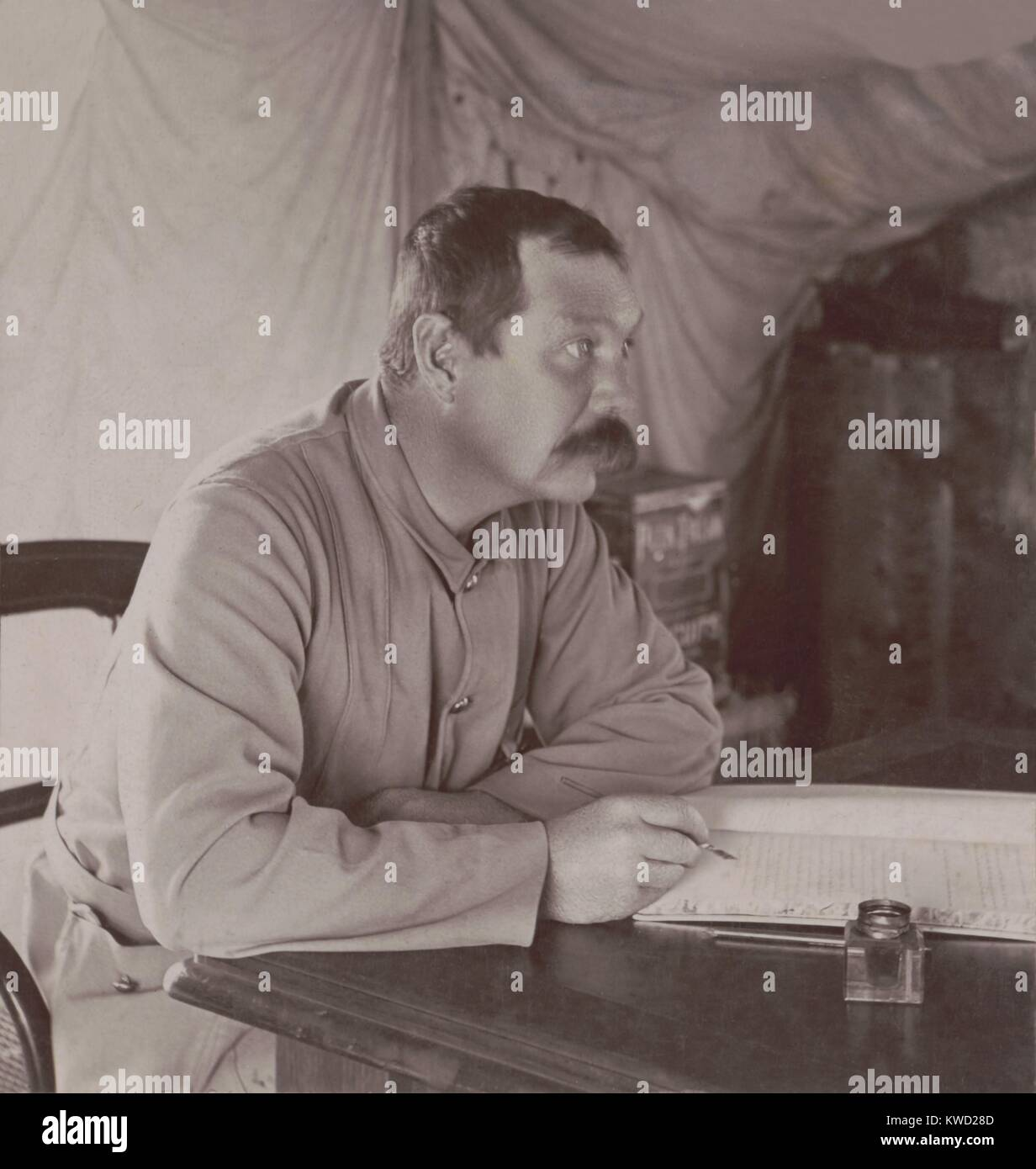 British author Conan Doyle in his tent at Bloemfontein, South Africa in 1900. He was writing THE GREAT BOER WAR, - Stock Image