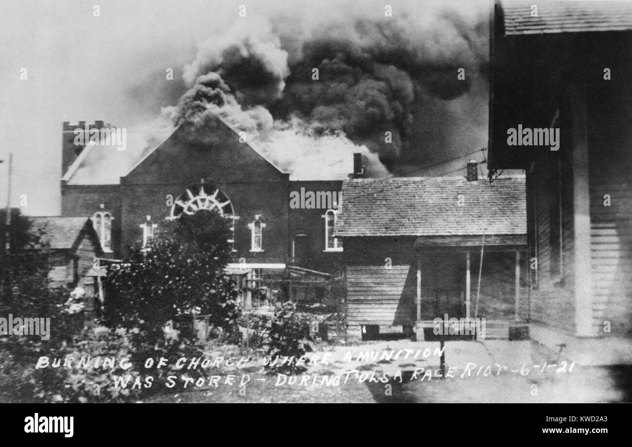 Postcard title reads: Burning of Church Where Ammunition was Stored-During Tulsa Race Riot-6-1-21. Mt. Zion Baptist - Stock Image