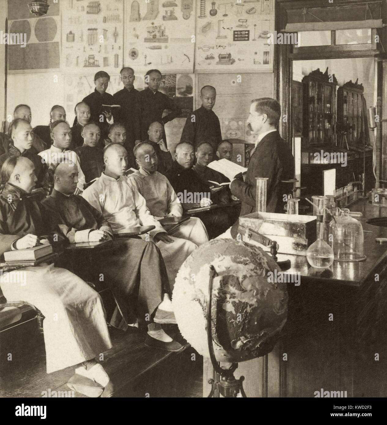 Classroom with Chinese men listening to an American lecturer in Shanghai, China, 1901. St. Johns American College, - Stock Image
