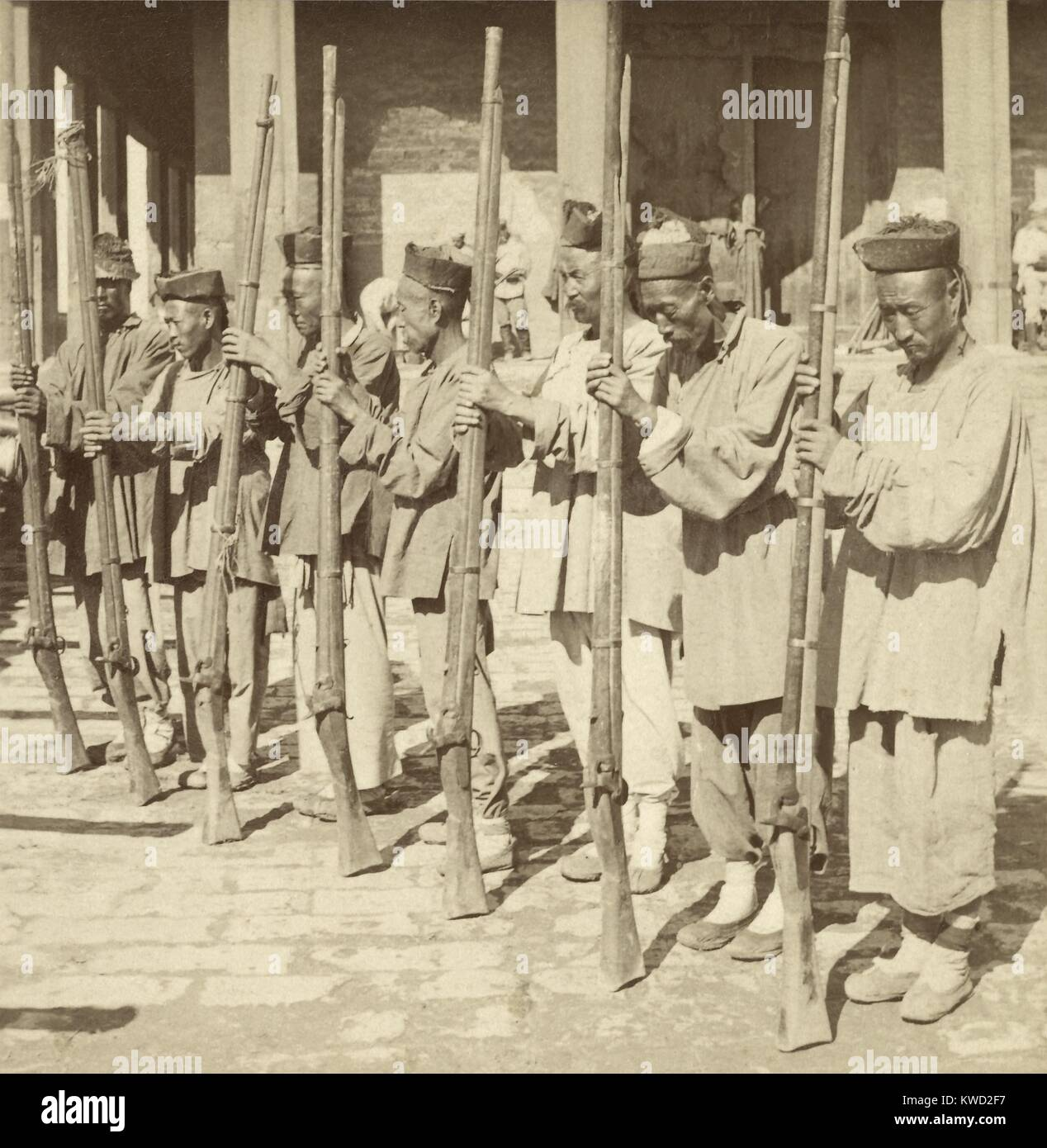 In Tianjin (Tientsin), China, Boxer rebel soldiers were armed with antique guns, June-July 1900. The regular Chinese - Stock Image