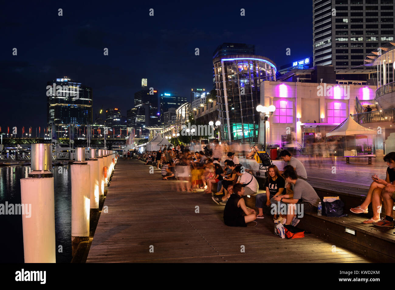 Cockle Bay Wharf in Darling Harbour by night - Sydney, New South Wales, Australia - Stock Image