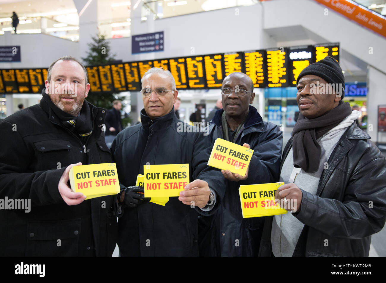 Members of the Birmingham Rail Group protesting about rail fare increases pictured at Grand Central, New Street - Stock Image