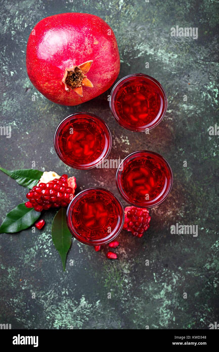 Glasses of fresh pomegranate juice.  - Stock Image