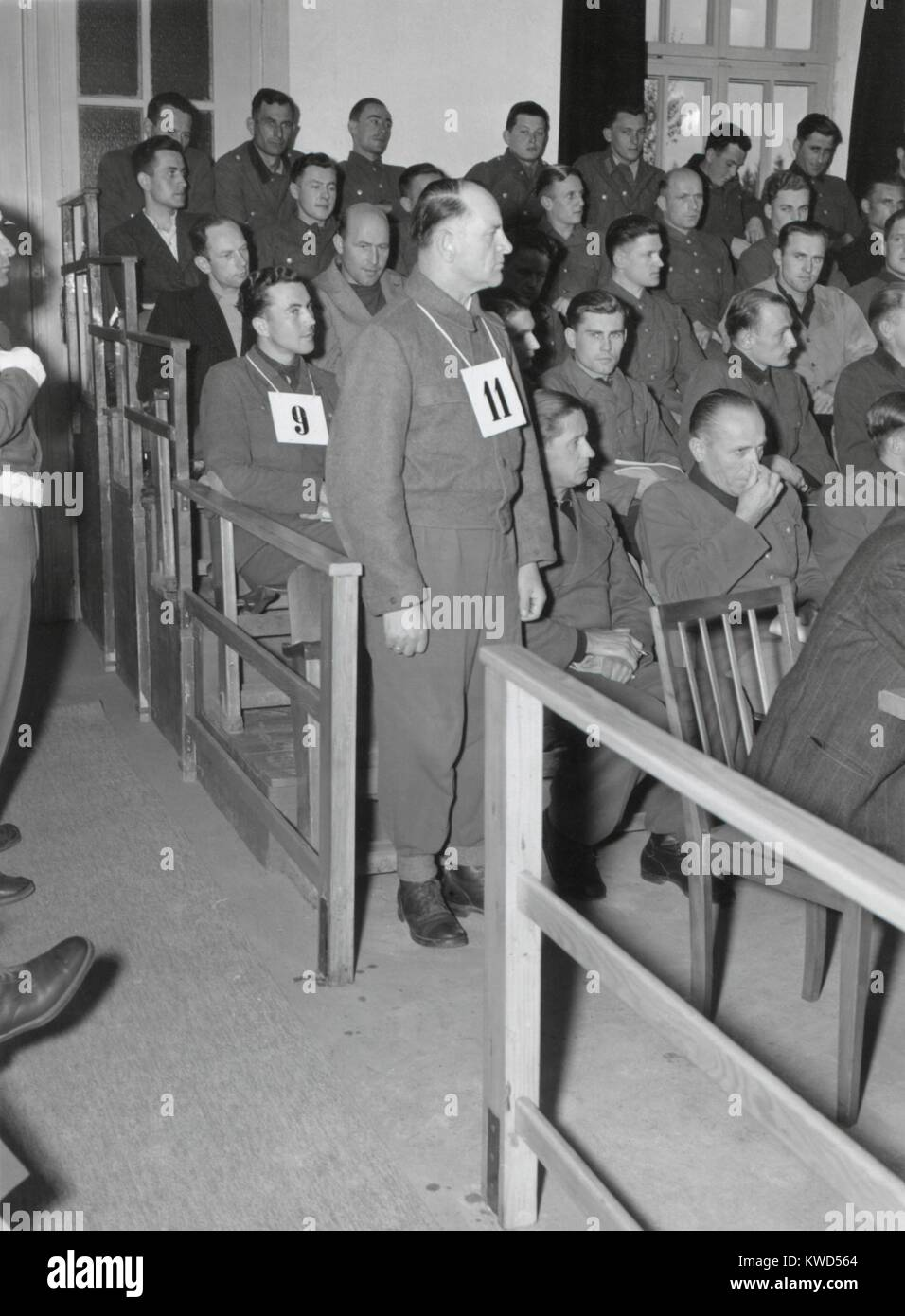 Josep Dietrich, Commander of the 6th Nazi SS Panzer Army, on trial for Malmedy Massacre. Standing with #11 hanging Stock Photo