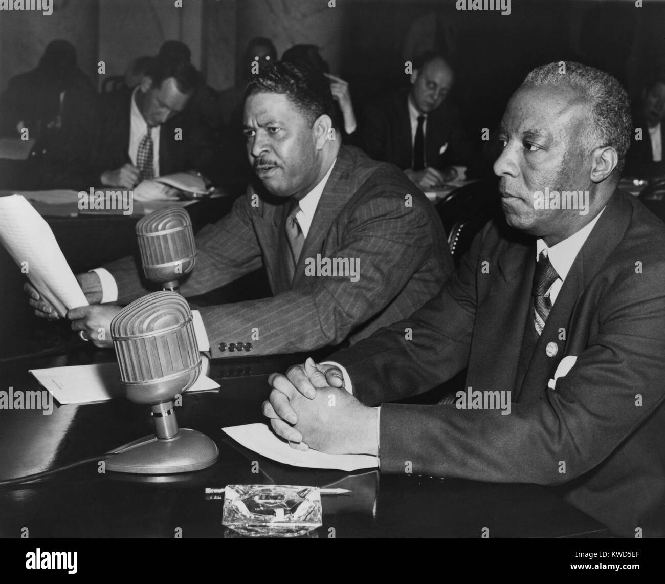 A. Philip Randolph (right) and Grant Reynolds testify at the Senate Armed Services Committee. 1948. Randolph and - Stock Image